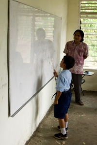Balinese boy learning to read, Pengulusan school